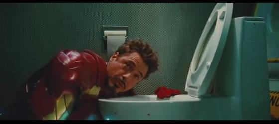 Tony  Stark vomitando toda sua ressaca na cena de abertura deletada de Iron Man 2.